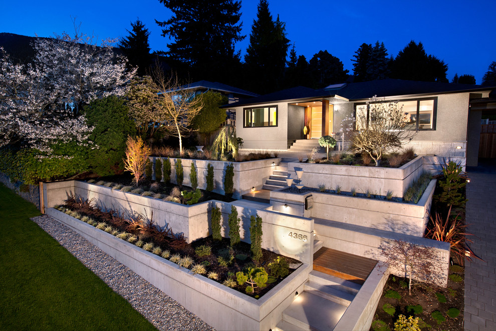 Mid-sized mid-century modern gray two-story concrete house exterior idea in Vancouver
