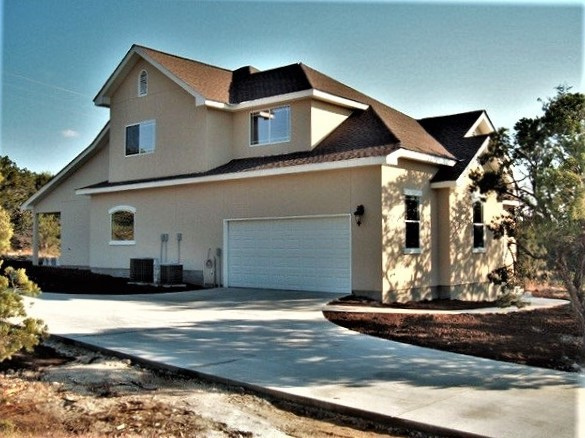 2 story stucco home at canyon lake transitional for 2 story lake house