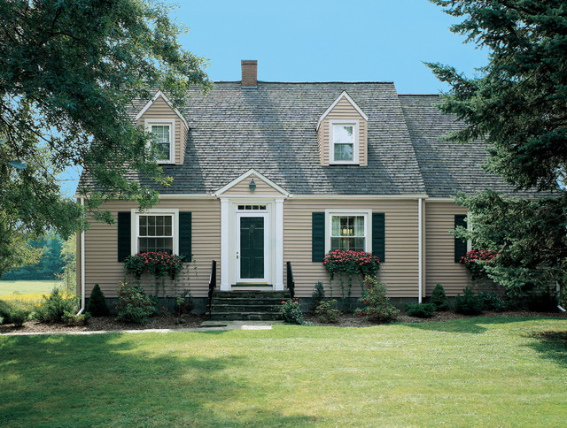 Cape cod built with vinyl and other polymeric siding for Cape cod exterior design
