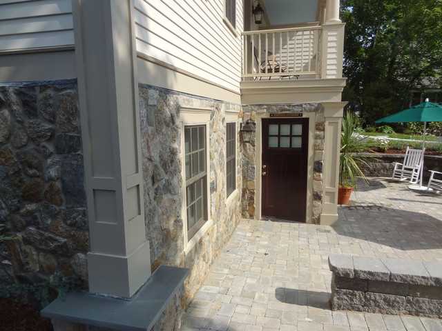 Cape Cod Inn With New England Stone Cladding Retaining Walls And Water Feat