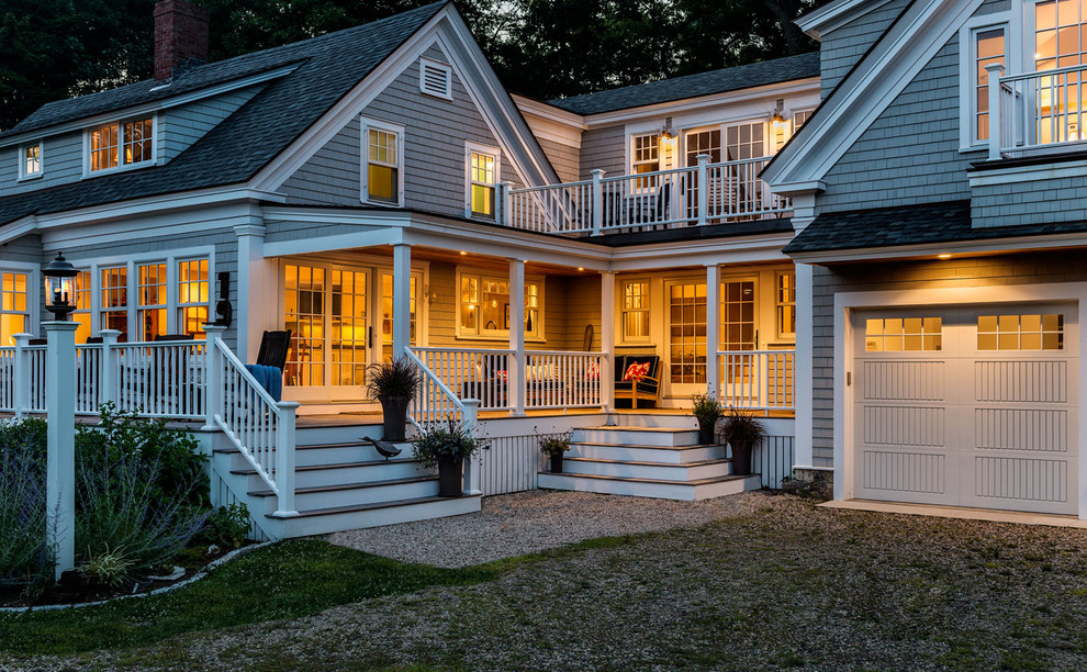 Inspiration for a mid-sized timeless gray two-story wood gable roof remodel in Boston