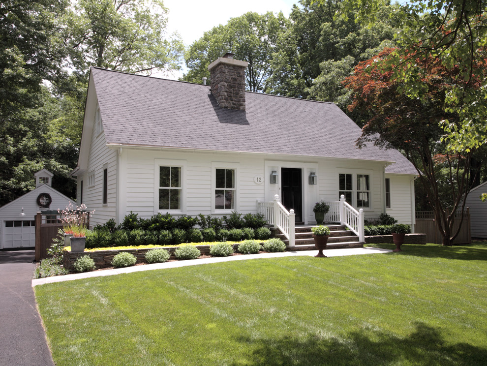 Example of a classic white one-story exterior home design in New York