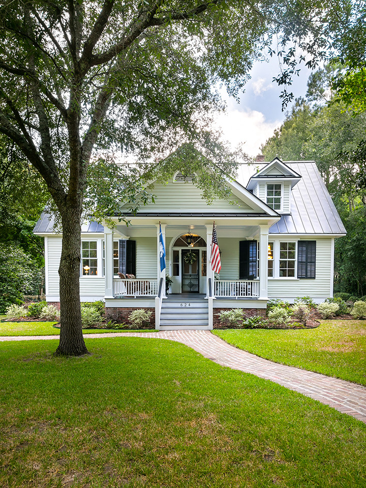 Mid-sized elegant gray two-story exterior home photo in Charleston