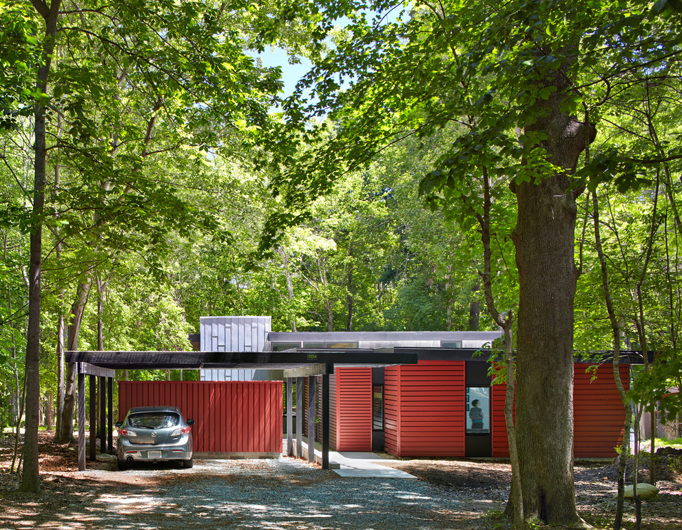 Trendy red one-story metal flat roof photo in Raleigh