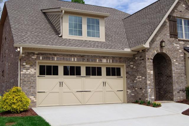 Carriage house steel traditional exterior nashville by wayne dalton garage doors - Installing carriage style garage doors improve exterior ...