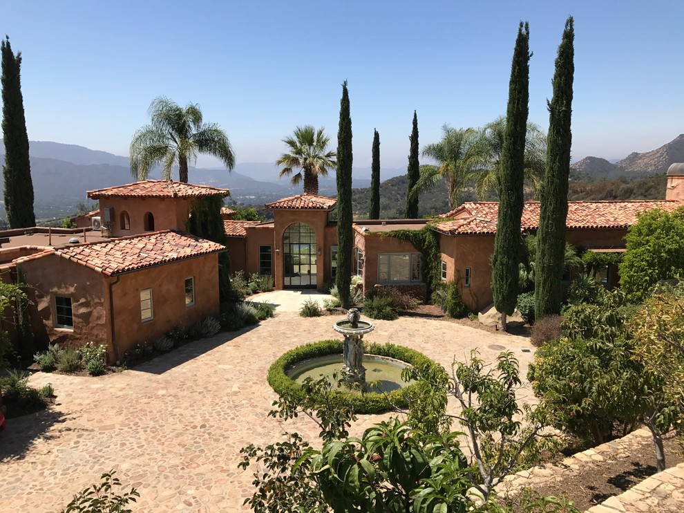 Tuscan brown one-story exterior home photo in Los Angeles with a tile roof
