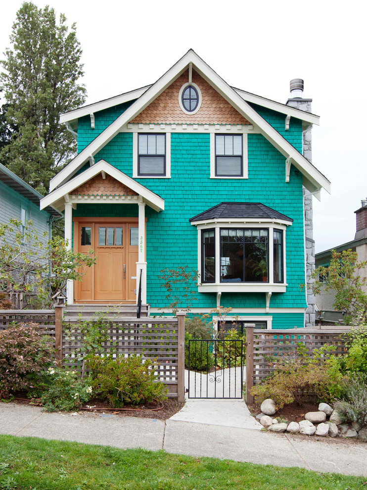 Victorian multicolored three-story wood exterior home idea in Vancouver