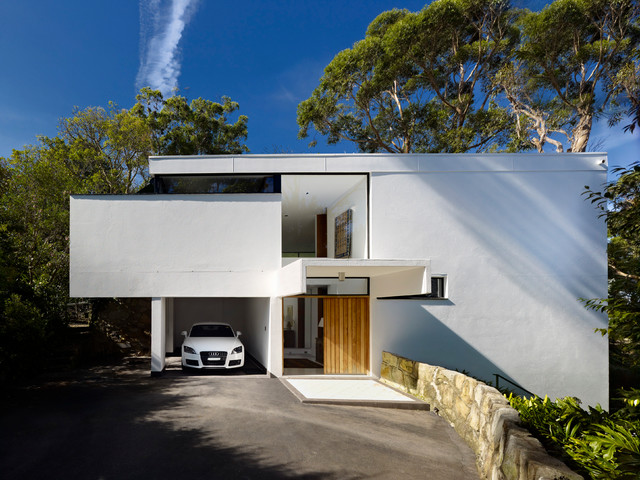 Mid-sized minimalist white exterior home photo in Sydney