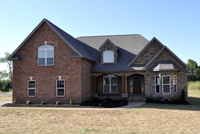 Cedar stone and brick exterior contemporary exterior for Home exterior design brick and stone