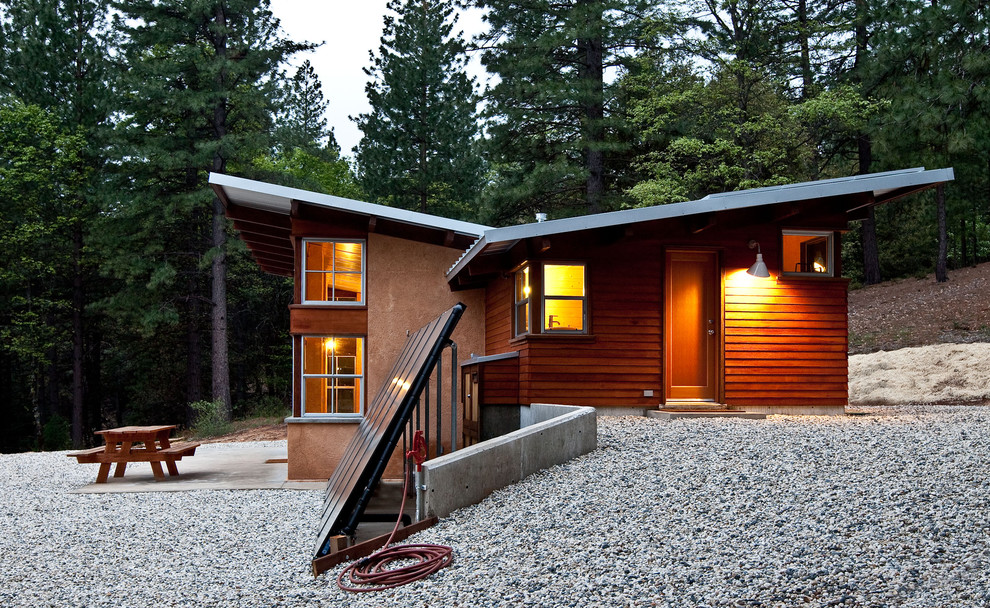 Inspiration for a rustic brown split-level wood exterior home remodel in Sacramento with a shed roof