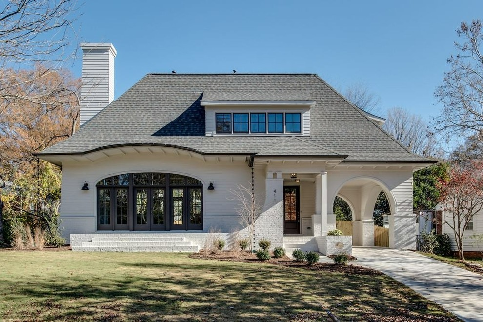 Example of a farmhouse exterior home design in Charlotte