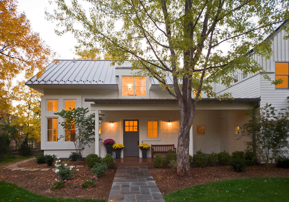 Example of a mid-sized farmhouse white two-story wood exterior home design in Denver with a metal roof and a white roof