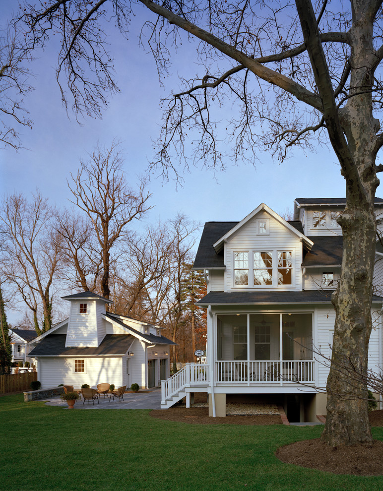 Inspiration for a timeless white two-story wood gable roof remodel in DC Metro