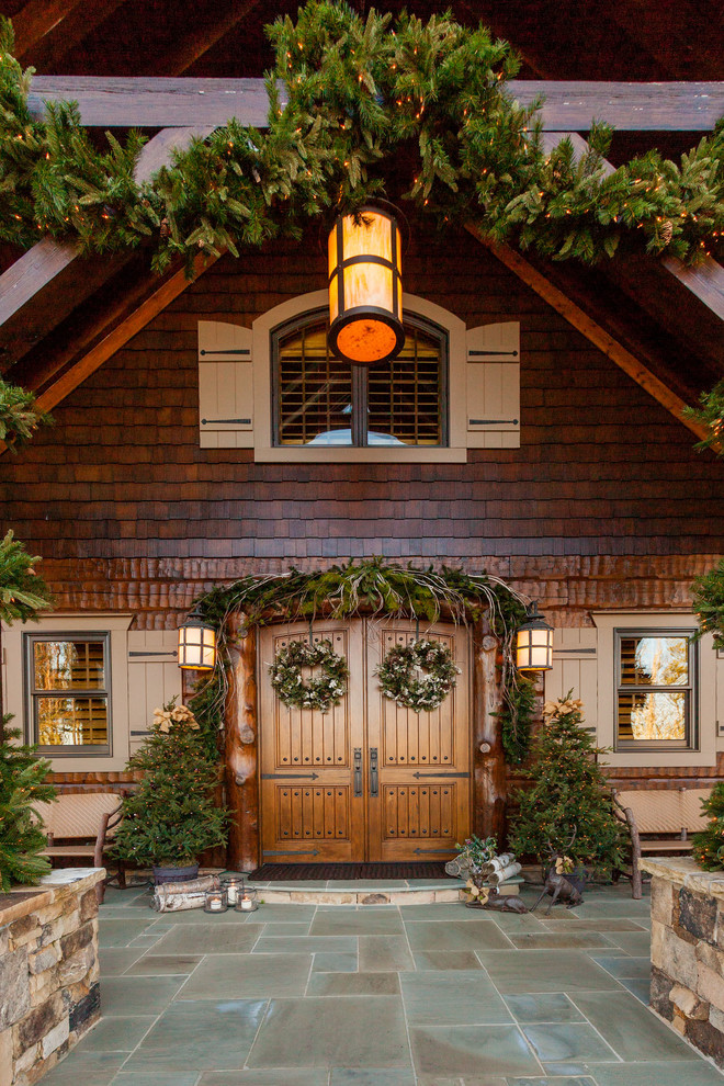 Inspiration for a large rustic brown wood house exterior remodel in Atlanta