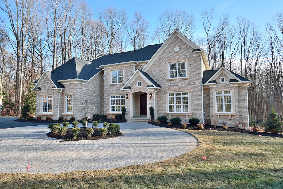 Huge transitional beige three-story brick house exterior idea in DC Metro with a hip roof and a shingle roof