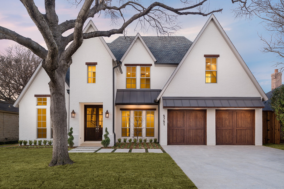 Large transitional white two-story gable roof photo in Dallas with a metal roof