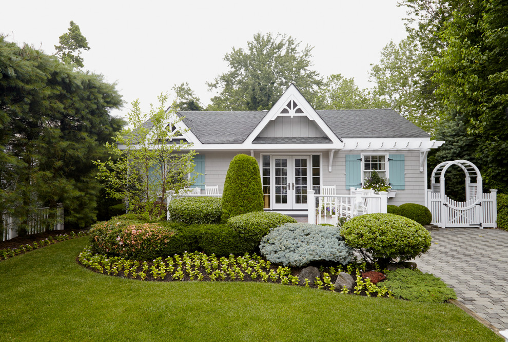 Coastal gray one-story wood exterior home idea in New York