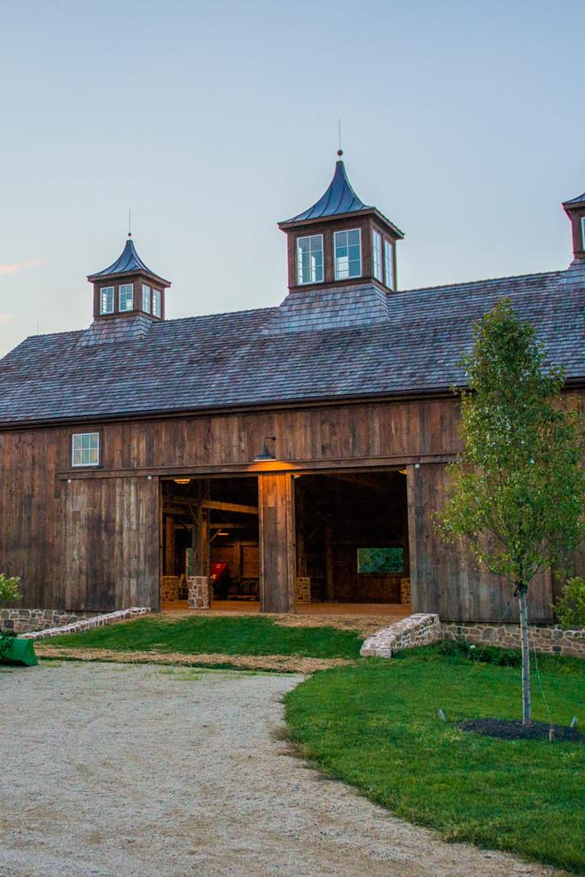 Huge country brown three-story wood gable roof idea in Bridgeport