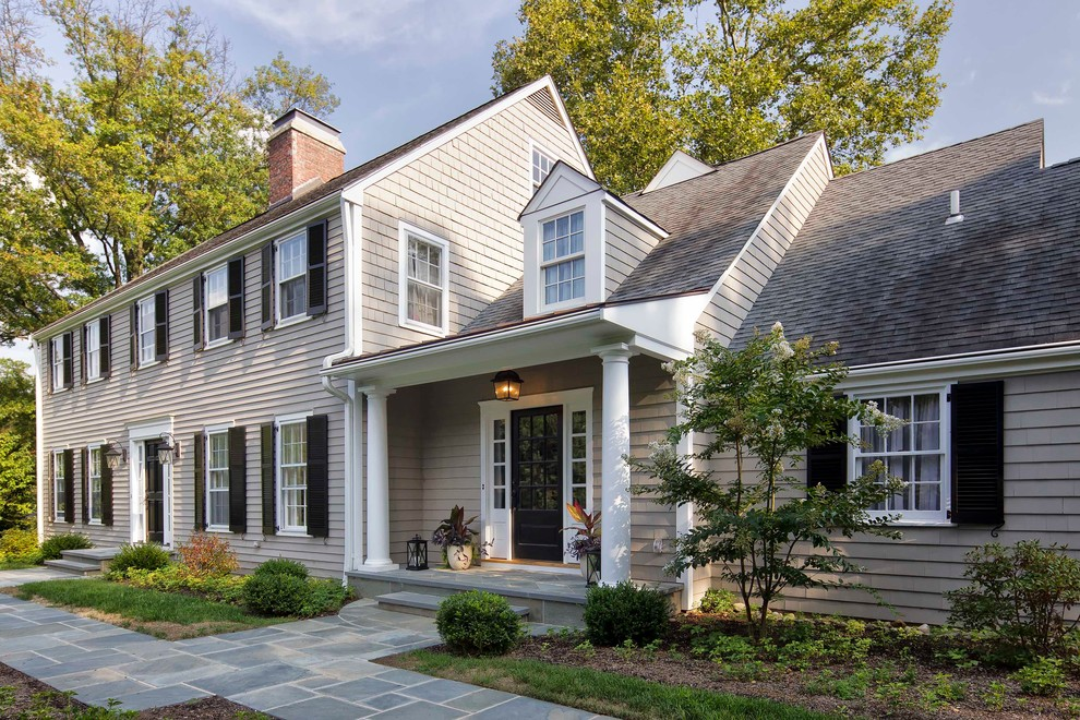 Inspiration for a timeless gray three-story concrete fiberboard exterior home remodel in New York with a shingle roof
