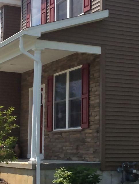 Close Up Of Front Gutters Downspouts White To Match Column