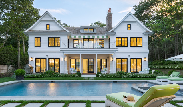 Inspiration for a large timeless white three-story wood gable roof remodel in New York