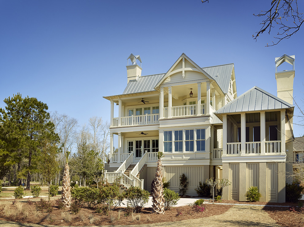 Beach style two-story wood exterior home photo in Charleston