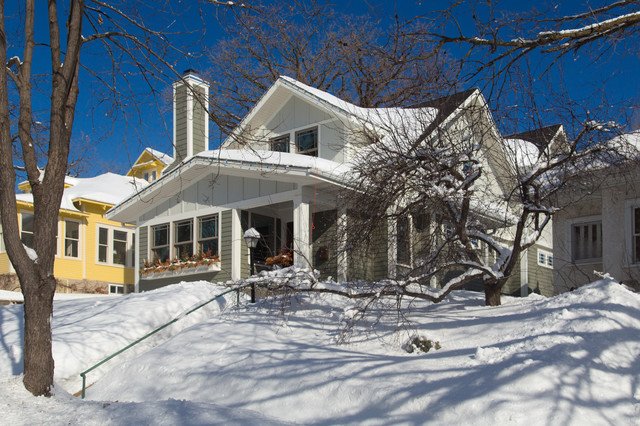 Example of a mid-sized arts and crafts gray two-story mixed siding exterior home design in Minneapolis