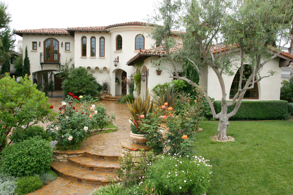 Inspiration for a mediterranean two-story exterior home remodel in Orange County