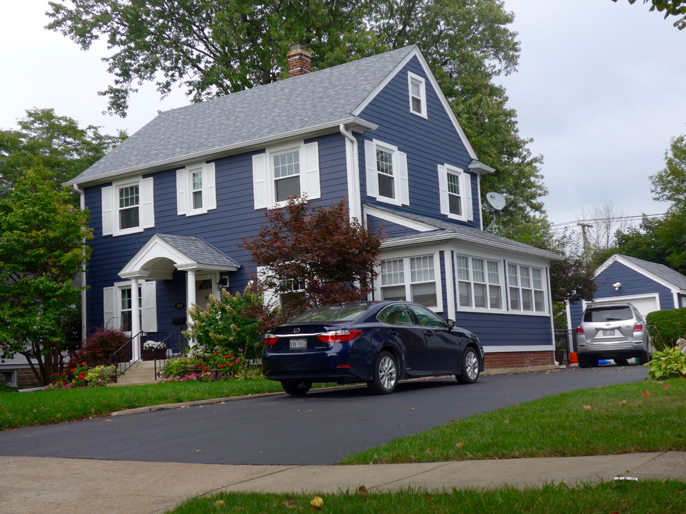 Mid-sized traditional blue two-story concrete fiberboard exterior home idea in Other with a shingle roof