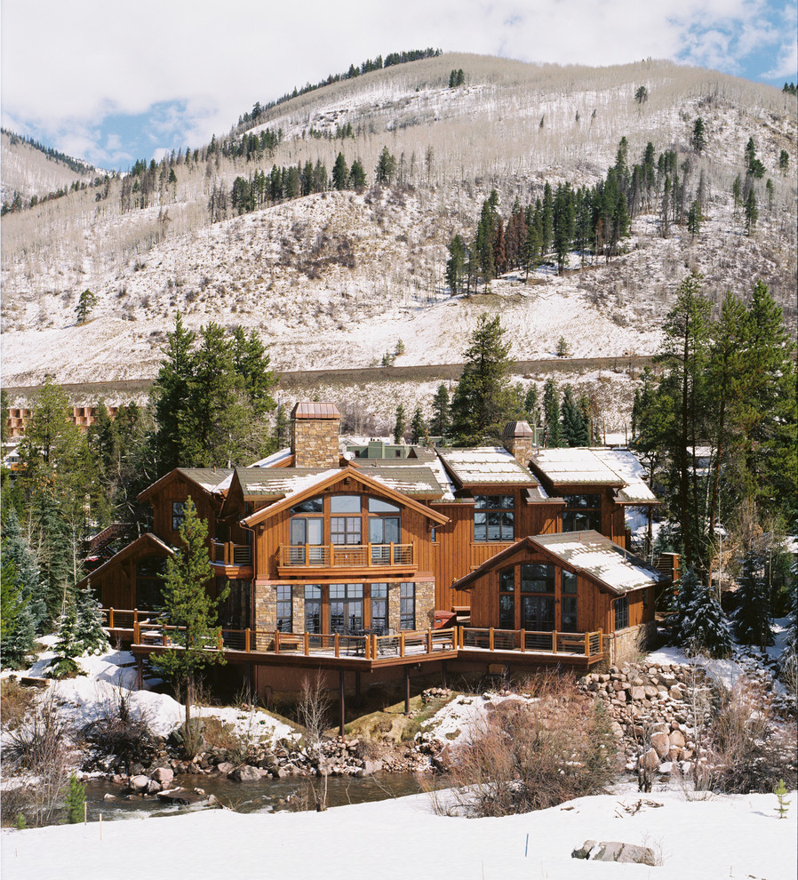 Mountain style wood exterior home photo in Denver