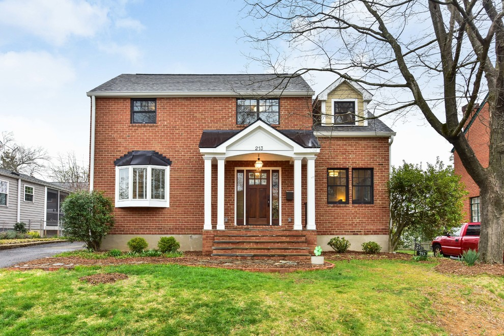 Inspiration for a mid-sized timeless beige three-story mixed siding house exterior remodel