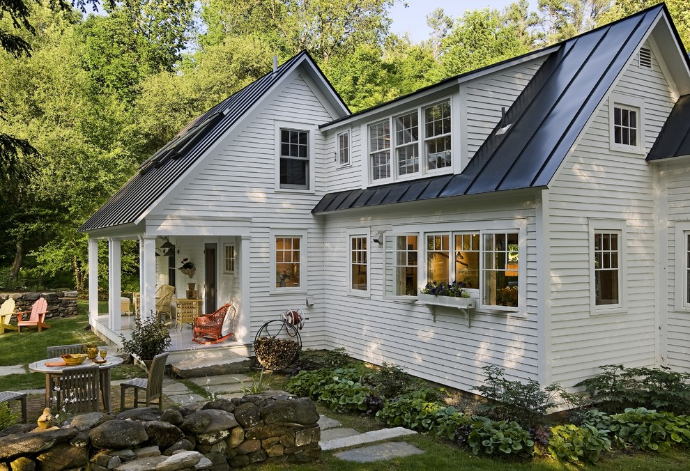 Inspiration for a small farmhouse two-story wood exterior home remodel in Burlington with a metal roof