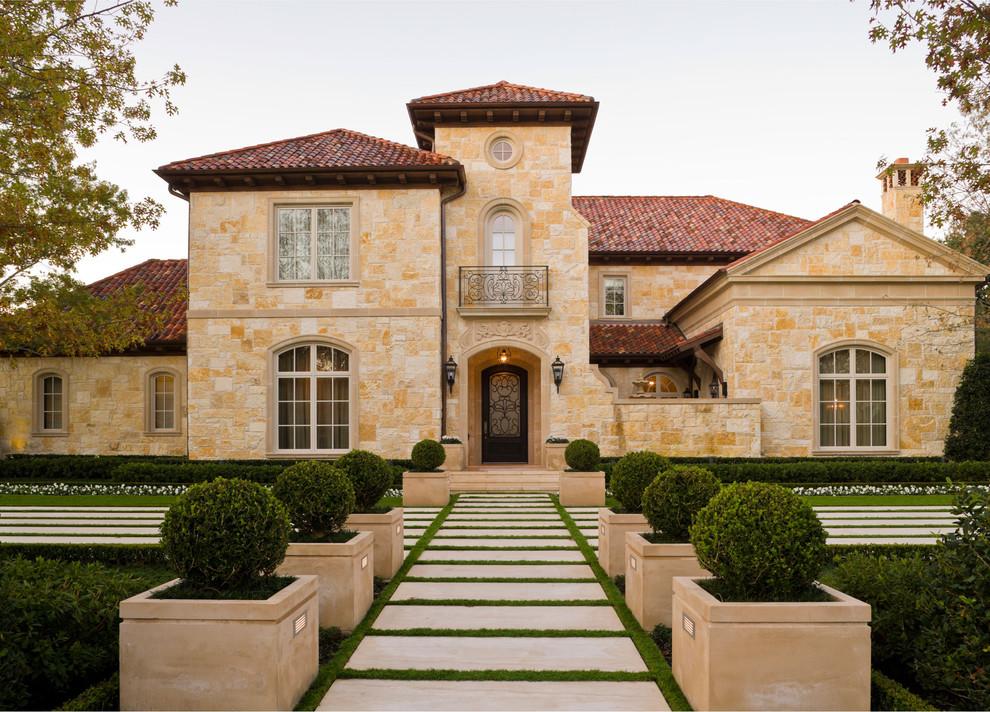 Mediterranean stone exterior home idea in Dallas