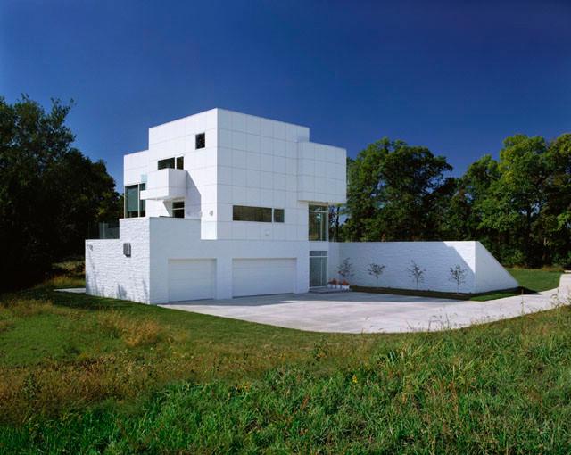 Contemporary cubist home ia contemporary exterior for Modern exterior building materials