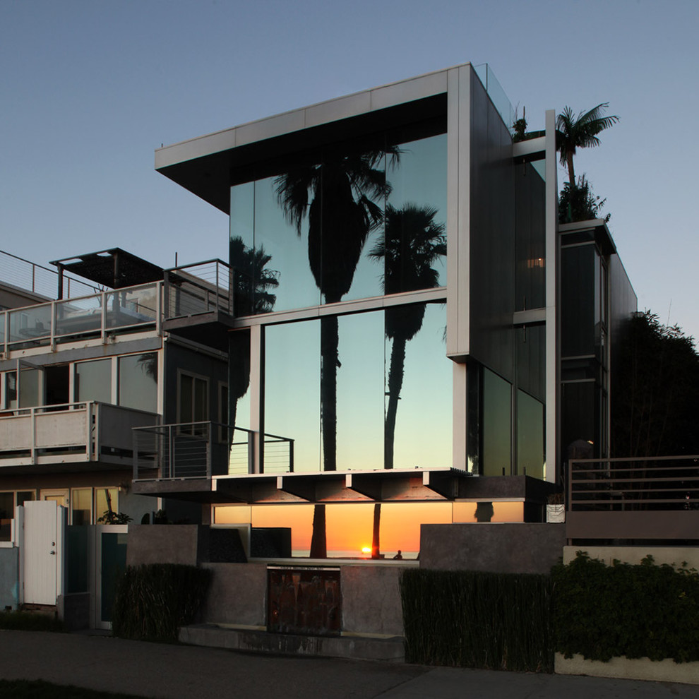 Contemporary two-story glass exterior home idea in Los Angeles