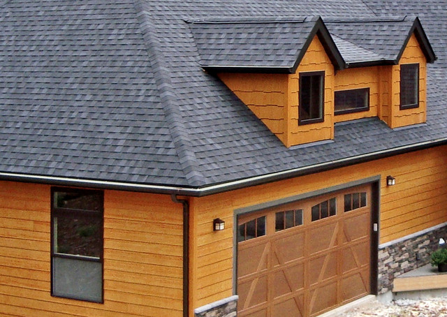 This house features lp smartside siding and shakes in diamond kote