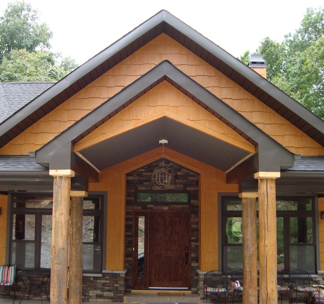 This house features lp smartside siding and shakes in diamond kote maple contemporary for Diamond kote lp siding colors