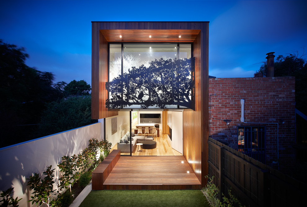 Inspiration for a mid-sized contemporary two-story flat roof remodel in Melbourne