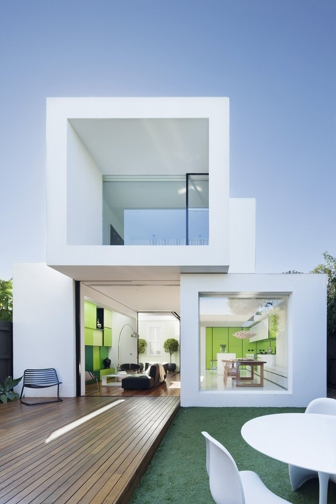 Inspiration for a contemporary white two-story flat roof remodel in San Francisco