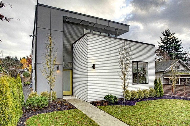 mid sized contemporary gray two story mixed siding flat roof idea in seattle