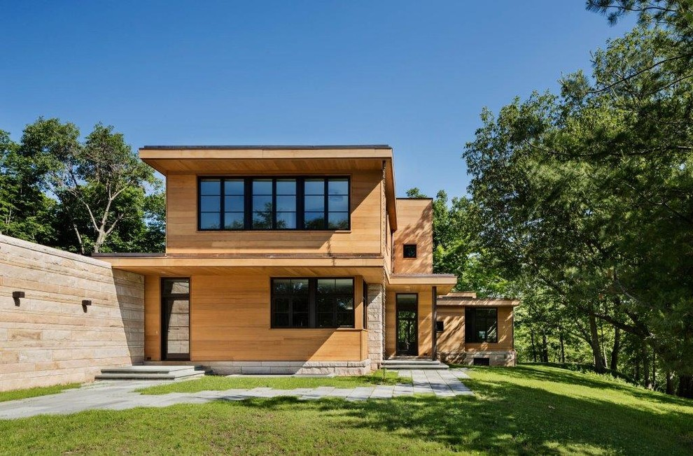 Example of a trendy two-story wood exterior home design in New York