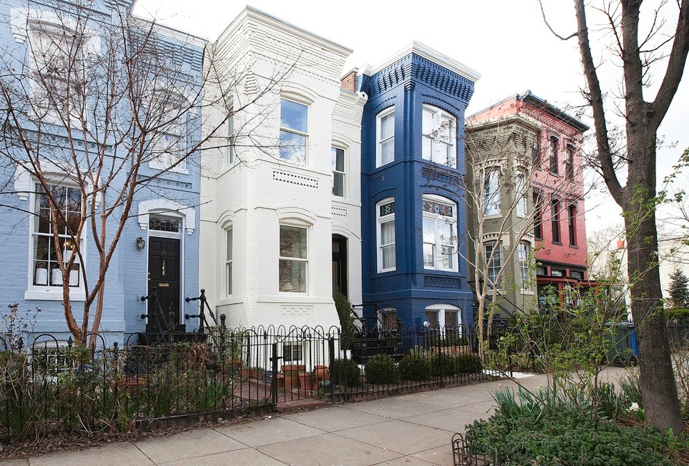 Ornate three-story exterior home photo in DC Metro