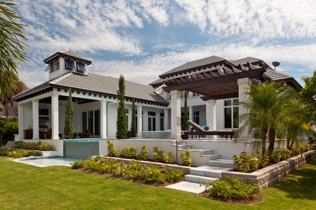 Nice Example Of A Large Island Style Two Story Exterior Home Design In Miami