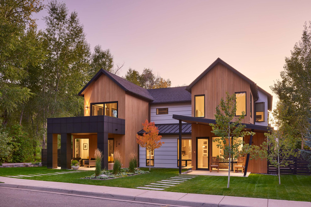 Mid-sized contemporary brown two-story mixed siding exterior home idea in Denver with a mixed material roof
