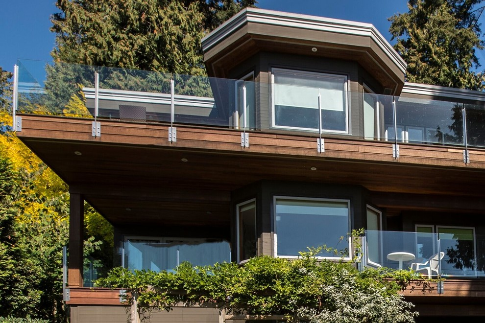 Example of a mid-sized trendy gray two-story mixed siding flat roof design in Vancouver