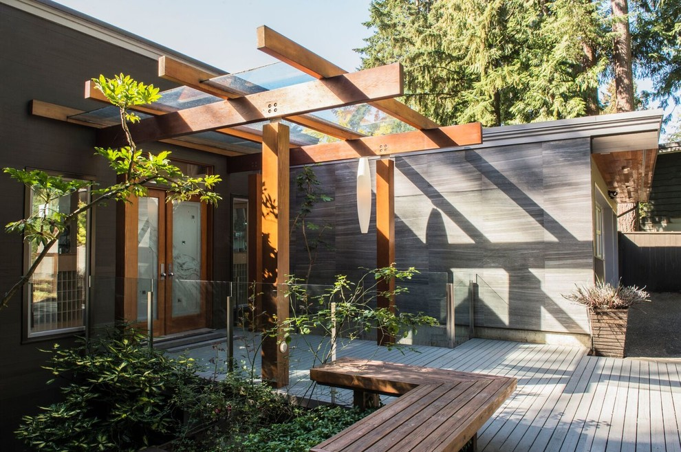 Inspiration for a mid-sized contemporary gray two-story mixed siding flat roof remodel in Vancouver