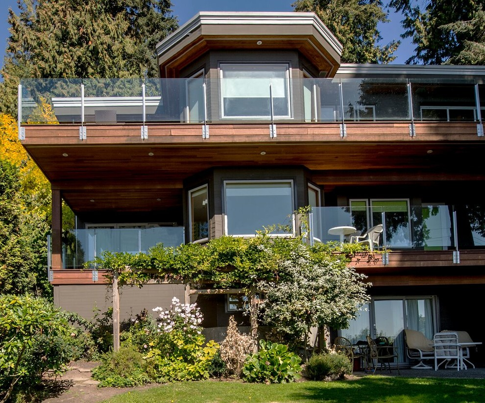 Mid-sized contemporary gray two-story mixed siding flat roof idea in Vancouver