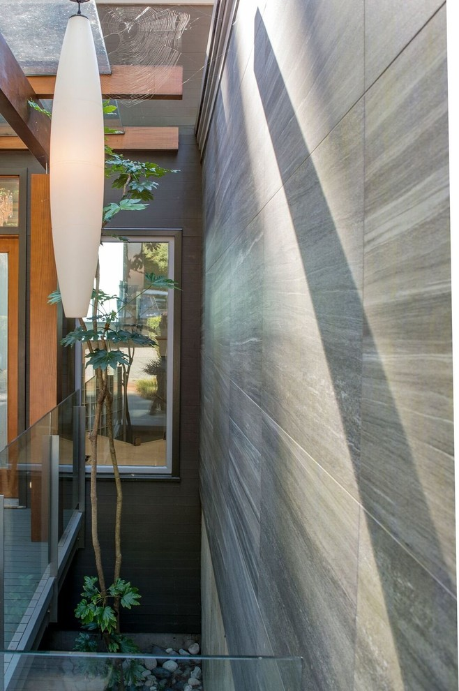 Mid-sized trendy gray two-story mixed siding flat roof photo in Vancouver
