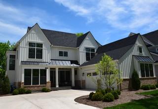 Contemporary white farmhouse custom home farmhouse for Custom farmhouse floor plans