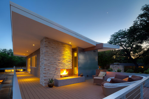 Home of stone contemporary house with stone veneer for Contemporary stone house exterior